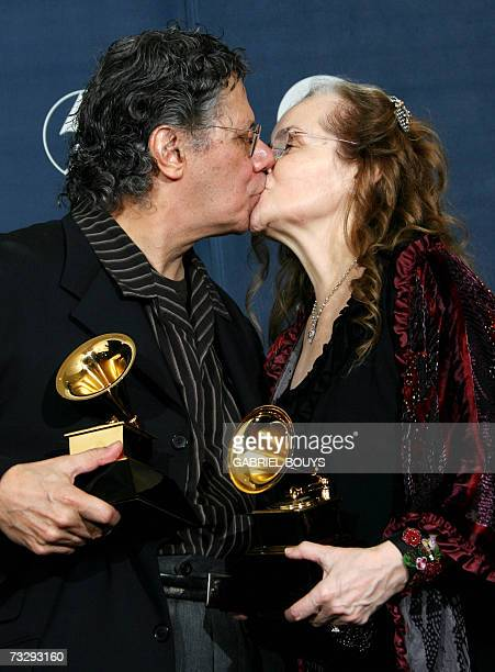 Winner for Best Jazz Instrumental Album Individual or Group and Best Instrumental Arrangement Chick Corea kisses his wife as he holds his trophies at...