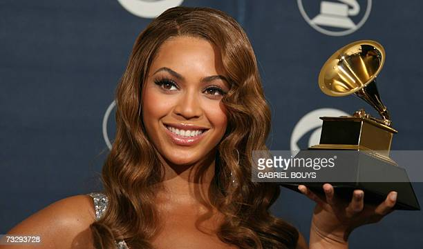 Winner of Best Contemporary RB Album Beyonce Knowles poses with the trophy at the 49th Grammy Awards in Los Angeles 11 February 2007 AFP...