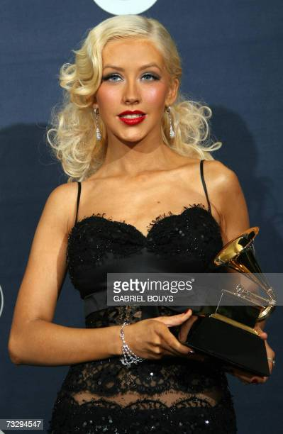 Los Angeles, UNITED STATES: Winner of Best Female Pop Vocal Performance Christina Aguilera poses with the trophy at the 49th Grammy Awards in Los...