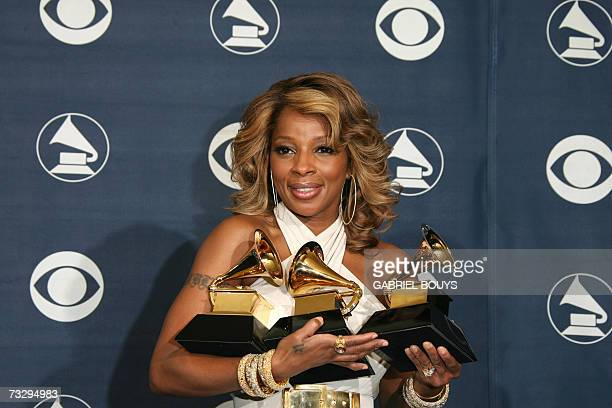 Los Angeles, UNITED STATES: Winner of Best Female R&B Vocal Performance, Best R&B Song and Best R&B Album Mary J. Blige poses with the trophies at...