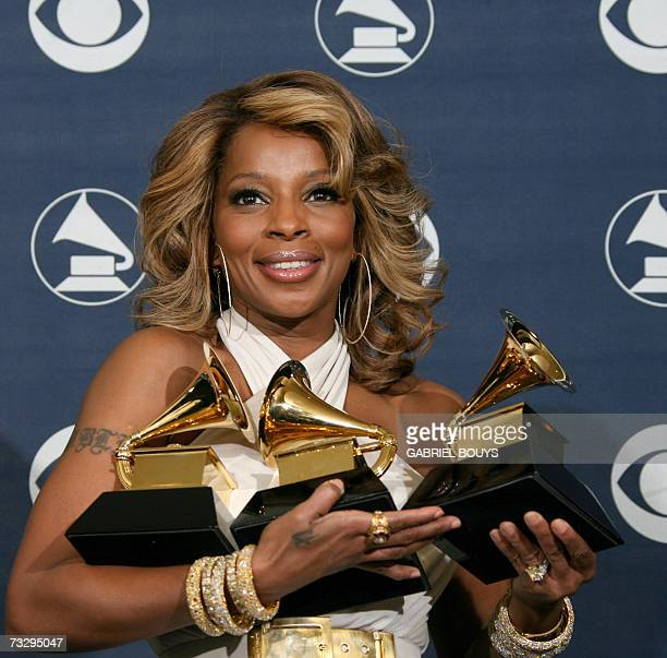 Los Angeles, UNITED STATES: Winner of Best Female R&B Vocal Performance, Best R&B Song and Best R&B Album, Mary J. Blige poses with her trophies...