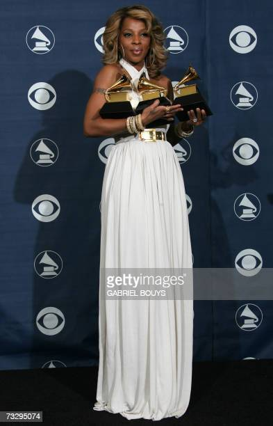 Winner of Best Female RB Vocal Performance Best RB Song and Best RB Album Mary J Blige poses with the trophies at the 49th Grammy Awards in Los...