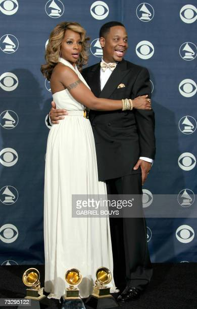 Los Angeles, UNITED STATES: Winner of Best Female R&B Vocal Performance, Best R&B Song and Best R&B Album, Mary J. Blige poses with her husband Kendu...