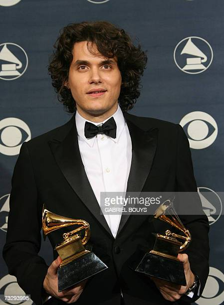 Los Angeles, UNITED STATES: Winner of Best Male Pop Vocal Performance and Best Pop Vocal Album John Mayer poses with the trophies at the 49th Grammy...