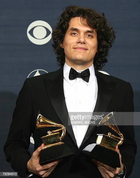 Winner of Best Male Pop Vocal Performance and Best Pop Vocal Album John Mayer poses with his trophies during the 49th Annual Grammy Awards in Los...