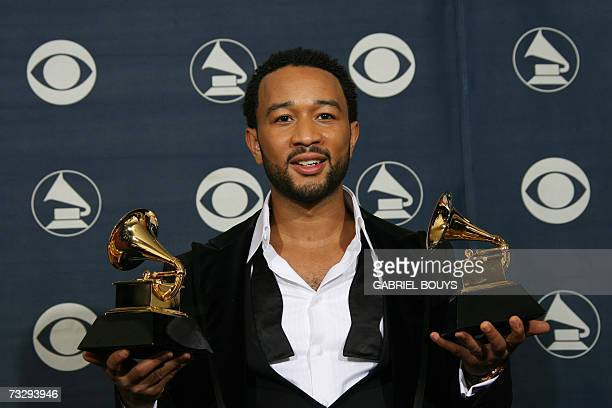 Winner of Best Male RB Vocal Performance and Best RB Performance By A Duo Or Group With Vocals John Legend poses with the trophies at the 49th Grammy...