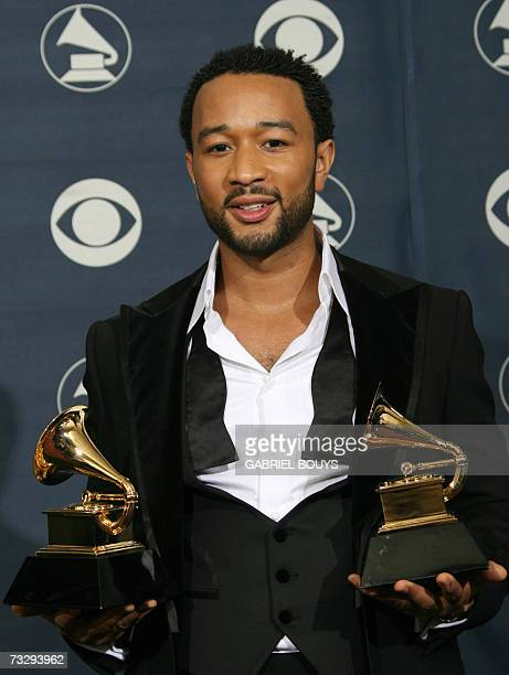 Los Angeles, UNITED STATES: Winner of Best Male R&B Vocal Performance and Best R&B Performance By A Duo Or Group With Vocals John Legend poses with...
