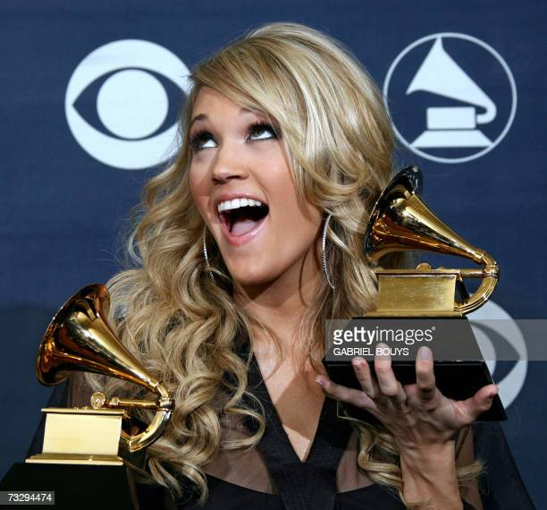 Winner of Best New Artist and Best Female Country Vocal Performance Carrie Underwood poses with her trophies at the 49th Grammy Awards in Los Angeles...
