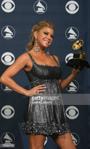Los Angeles, UNITED STATES: Winner of the Best Pop Performance by a Group, singer Fergie of the Black Eyed Peas poses with the trophy at the 49th...