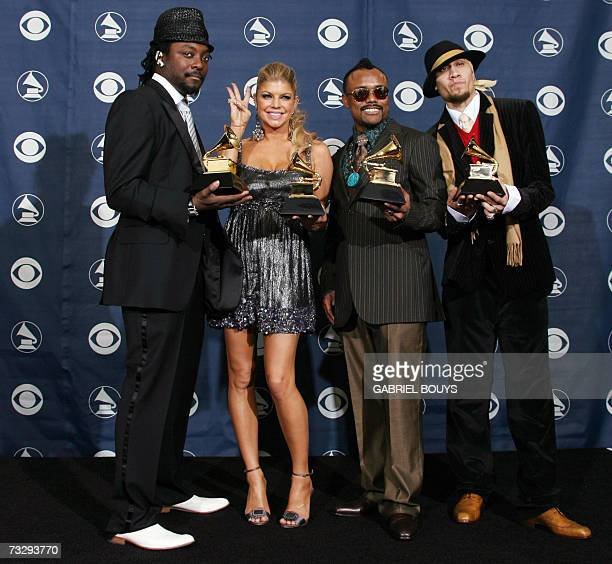 Winners of the Best Pop Performance by a Group The Black Eyed Peas pose with the trophy at the 49th Grammy Awards in Los Angeles 11 February 2007 AFP...