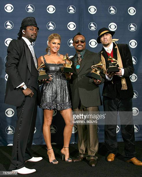 Los Angeles, UNITED STATES: Winners of the Best Pop Performance by a Group, the Black Eyed Peas pose with their trophies at the 49th Grammy Awards in...