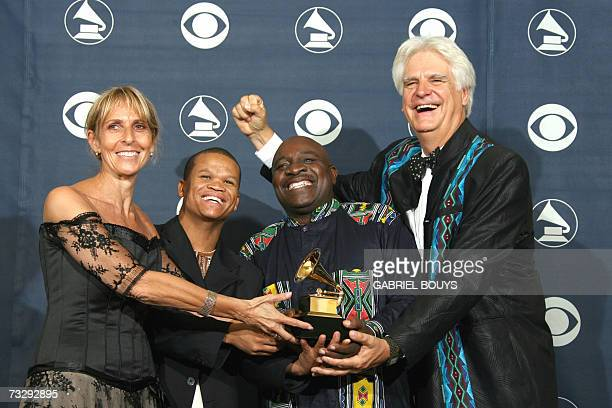 Winners of Traditional World Music Album the Soweto Gospel Choir pose with their trophy at the 49th Grammy Awards in Los Angeles 11 February 2007 AFP...