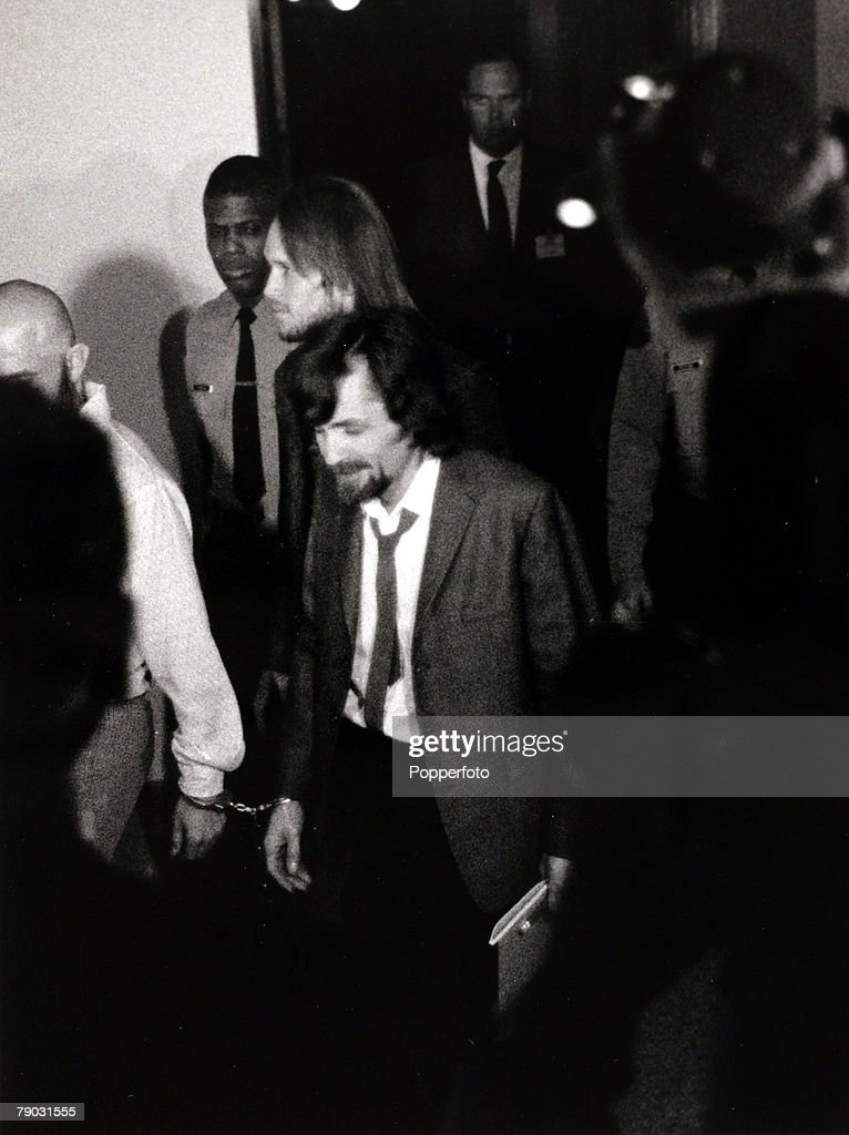 Los Angeles, USA, 25th January 1971, American cult leader Charles Manson (beard) is led in handcuffs into a courtroom to stand trial during the 'Manson Family' Sharon Tate murder trial