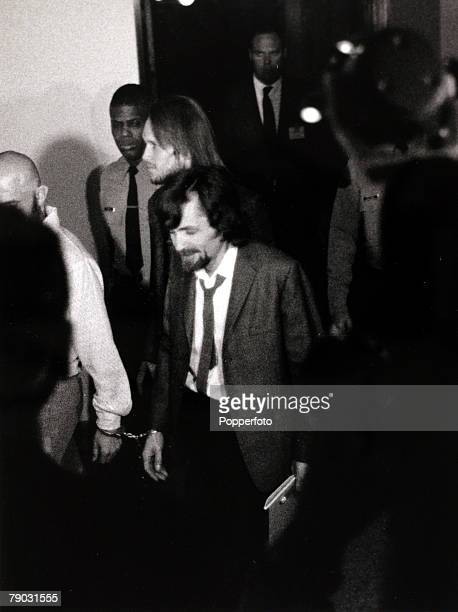 Los Angeles USA 25th January 1971 American cult leader Charles Manson is led in handcuffs into a courtroom to stand trial during the Manson Family...