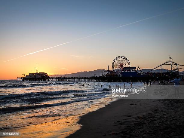 USA, Los Angeles, view to Santa Monica pier and Pacific Park at sunset