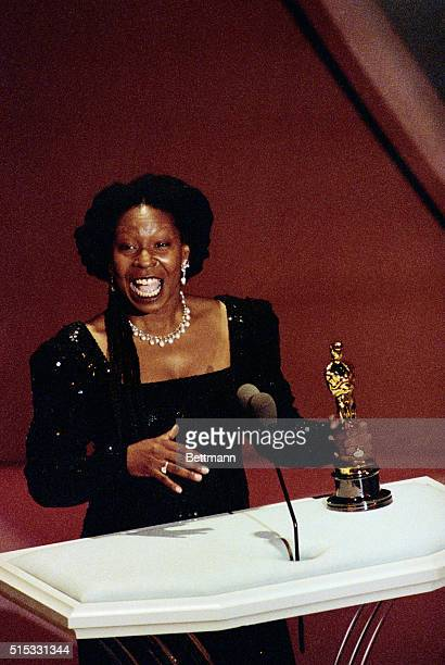Whoopi Goldberg holds her Best Supporting Actress Oscar for her role in Ghost March 25
