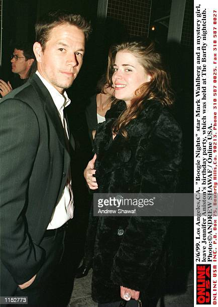 2/6/99 Los AngelesCA 'Boogie Nights' star Mark Wahlberg and a mystery girl leave Jennifer Aniston's birthday party which was held at The Barfly...
