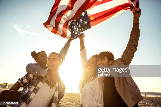 los angelinos on the venice beach boulevard and beach having fun in a sunny day in california - fourth of july stock pictures, royalty-free photos & images