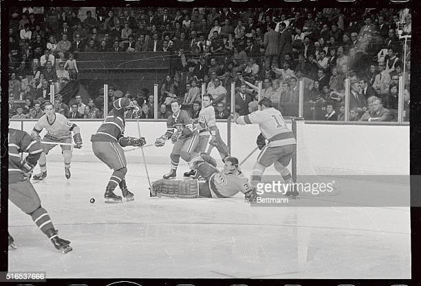 Los Angelis Kings' goalie Gerry Desjardins makes a spectacular save off Canadiens' Serge Savard Kings' Brent Hughes takes Canadiens' Bobby Rousseau...