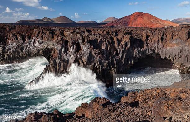los hervideros caves viewpoint, lanzarote, canary islands, spain - national park stock pictures, royalty-free photos & images