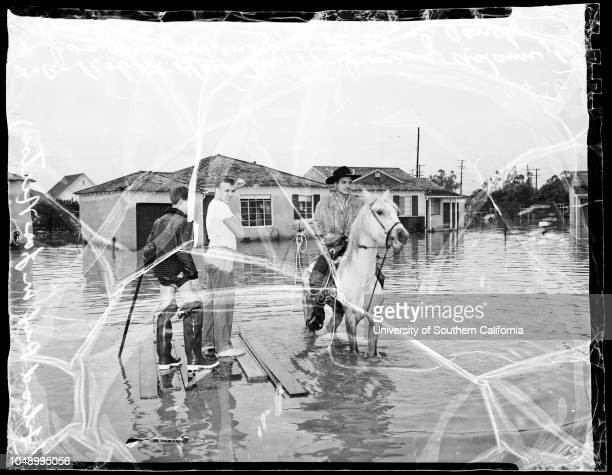 Los Nietos storm pictures Street two feet under water Flood did not invade houses East Verbeck Street 18 January 1952 Mrs Charles Miller 11617 East...