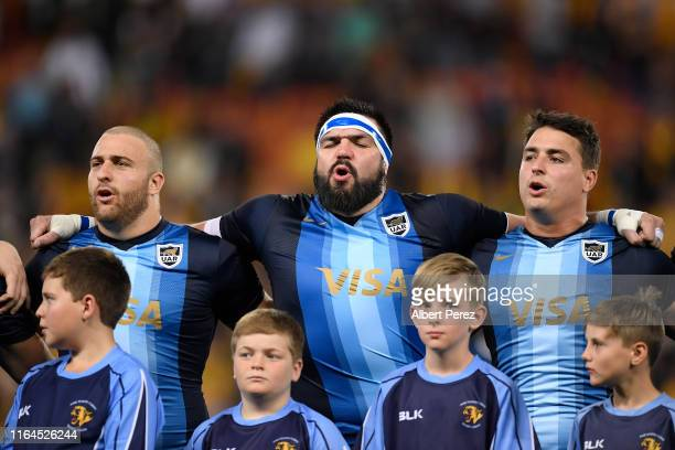 Los Pumas players Lucas Mensa, Ramiro Herrera and Matias Moroni sing the national anthem during the 2019 Rugby Championship Test Match between...