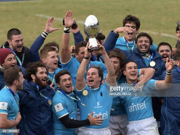Los Teros Uruguay's national rugby team captain Manuel Gaminara rises the trophy to celebrate their win over Spain in the final of the World Rugby...