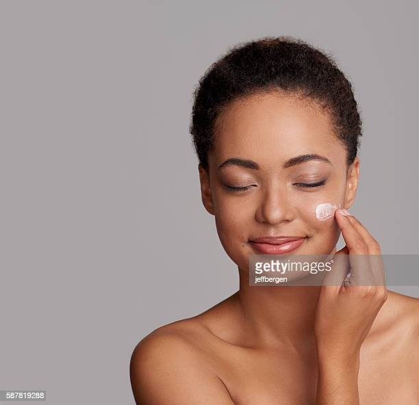 lose yourself in the ultimate softness of this cream - cheek stock pictures, royalty-free photos & images