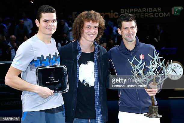 Loser of the final Milos Raonic Football player David Luiz and winner of the tournament Novak Djokovic attend the Final match during day 7 of the BNP...