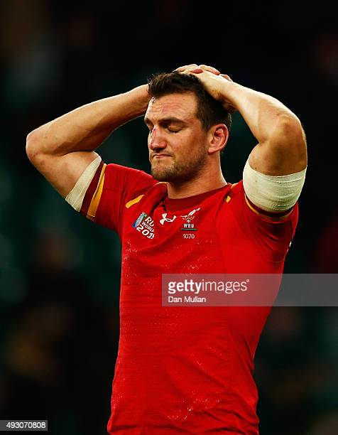 Losing Captain Sam Warburton of Wales holds his head in his hands and looks dejected after during the 2015 Rugby World Cup Quarter Final match...