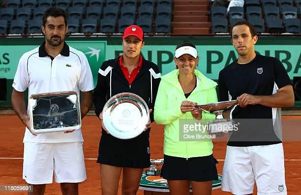 Losing finalists Nenad Zimonjic of Serbia and Katarina Srebotnik of Slovenia pose alongside champions Casey Dellacqua of Australia and Scott Lipsky...