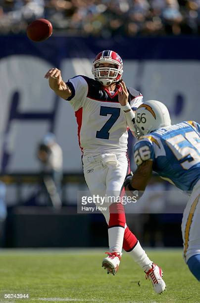 Losman of the Buffalo Bills passes against Shawne Merriman of the San Diego Chargers on November 20 2005 at Qualcomm Stadium in San Diego California...