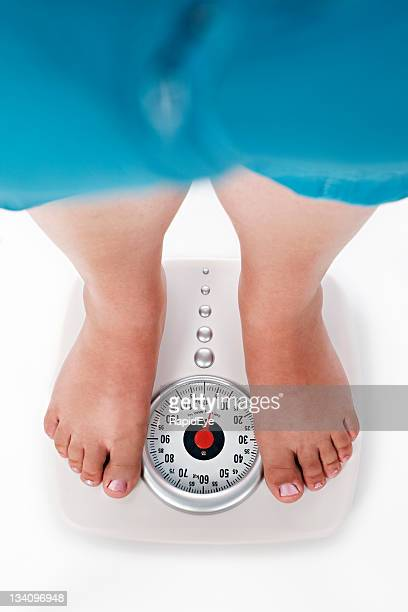 loss or gain? the scales reveal all - fat legs stock photos and pictures
