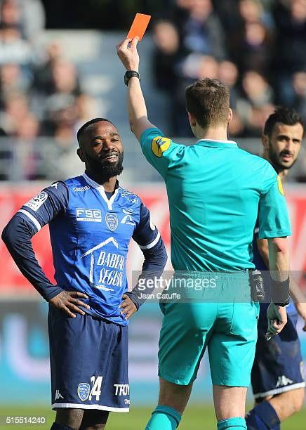 Lossemy Karaboue of Troyes receives a red card from referee Francois Letexier during the French Ligue 1 match between ESTAC Troyes and Paris...