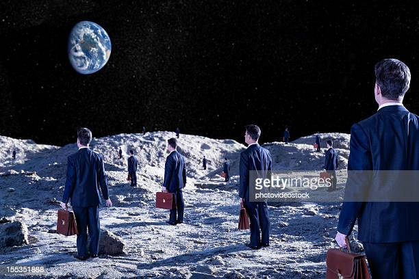 Lost and confused businessmen on moon's surface