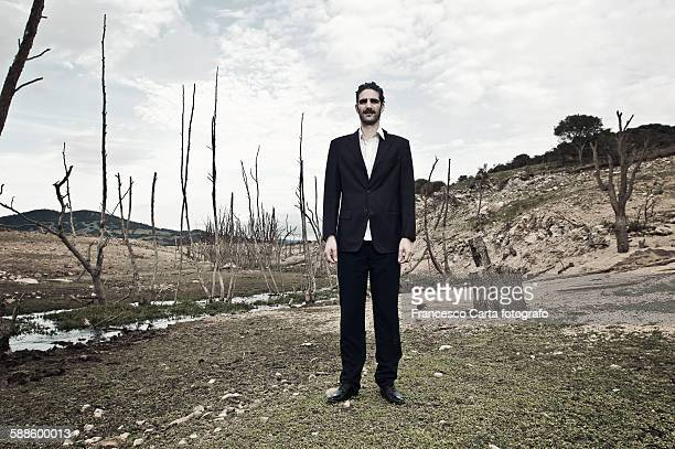 lost businessman in a dry river - lake bed stock photos and pictures