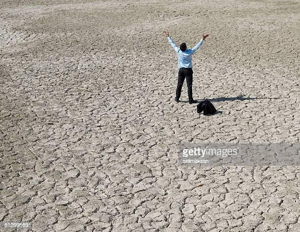 Lost businessman in desert looking for help