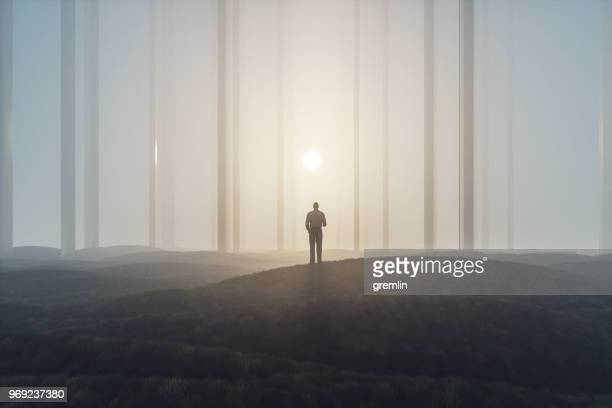 lost businessman in foggy landscape with mirror columns - mystery stock pictures, royalty-free photos & images
