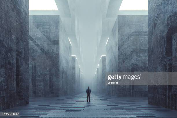 Lost businessman in futuristic dark ominous concrete city