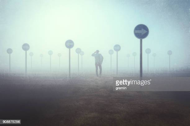 lost businessman - fog stock pictures, royalty-free photos & images