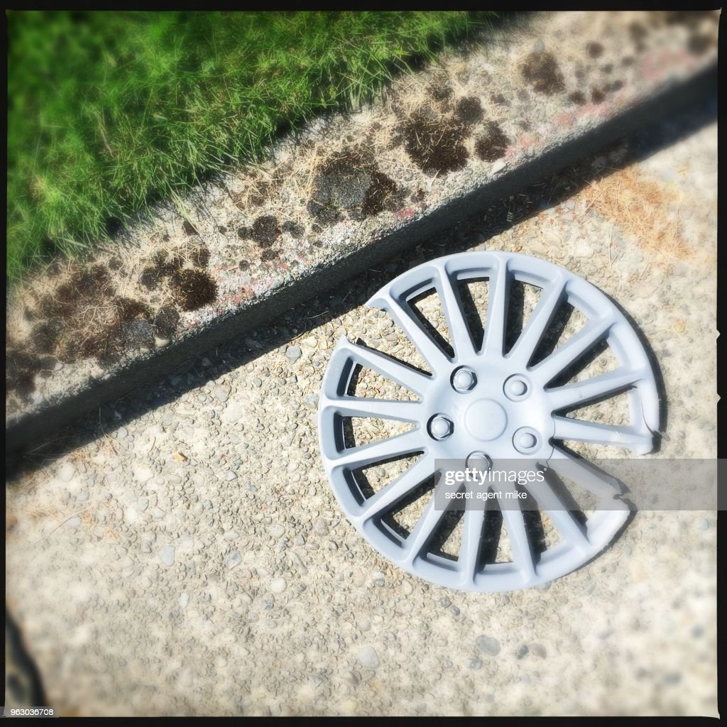Lost Hubcap Stock Photo - Getty Images