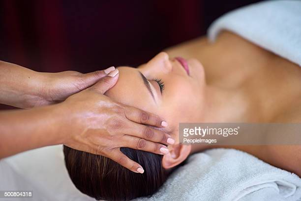 lost in blissful spa dreams - head massage stock photos and pictures