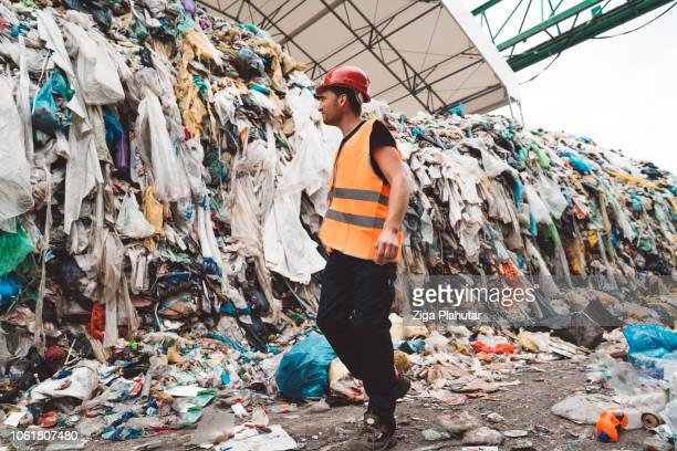 lost in garbage - clothing stock pictures, royalty-free photos & images