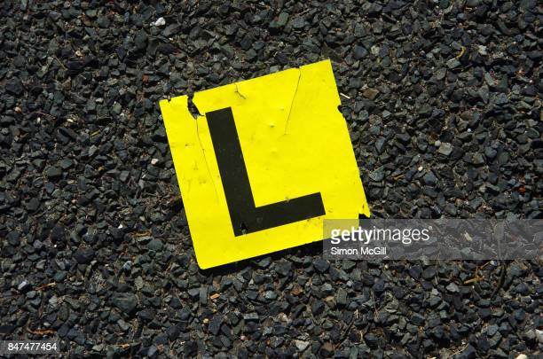 Lost learners permit L plate on a bitument road in Port Macquarie, New South Wales, Australia
