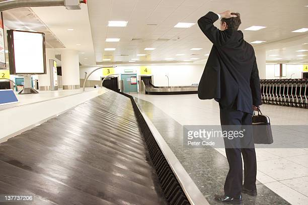 lost luggage at airport. - baggage claim stock pictures, royalty-free photos & images