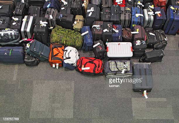 lost luggage in the airport - luggage stock pictures, royalty-free photos & images