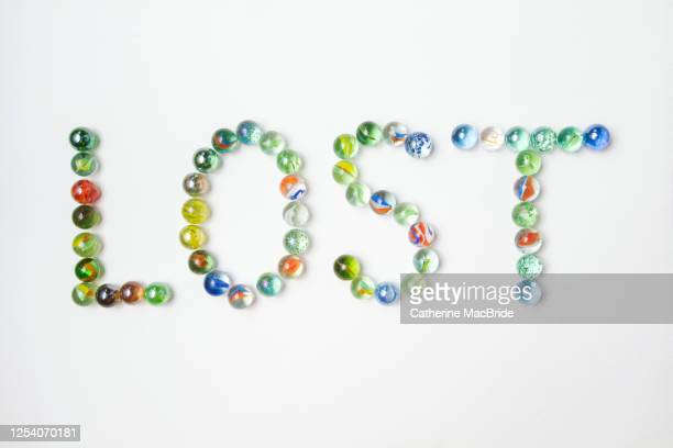 lost marbles - catherine macbride stock pictures, royalty-free photos & images
