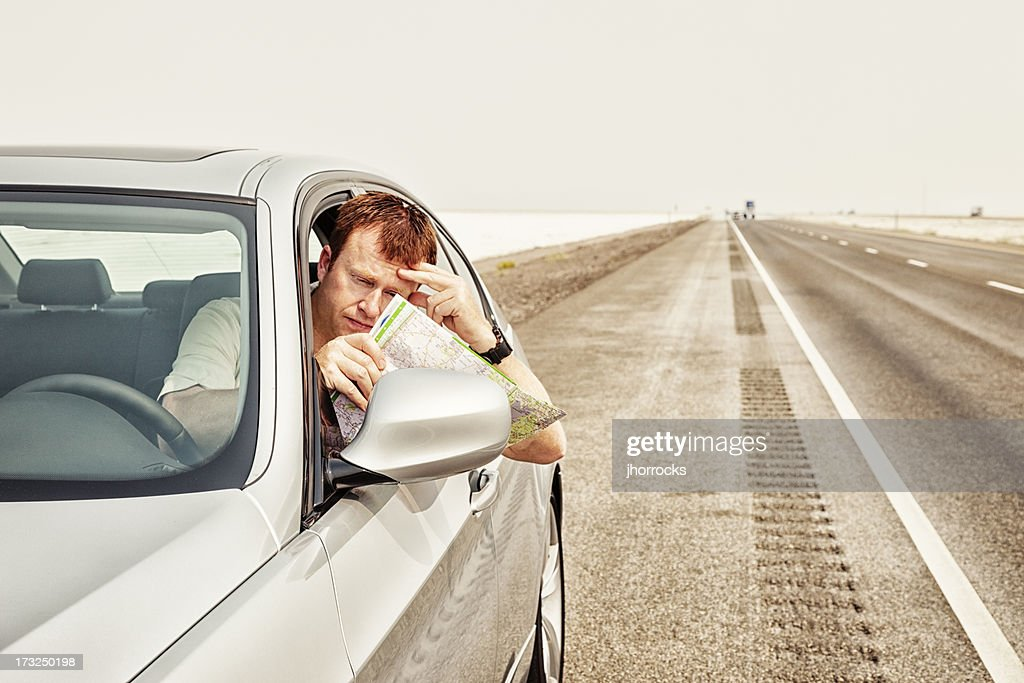 Lost Motorist Reading Map : Stock Photo