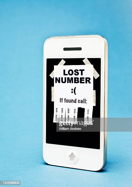 'Lost Number' poster taped on a smartphone