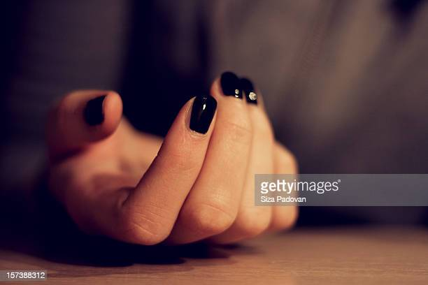 lost - black nail polish stock photos and pictures